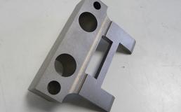 Machining of square holes